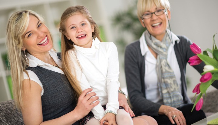 Happy portrait of grandmother, mother and daughter at home