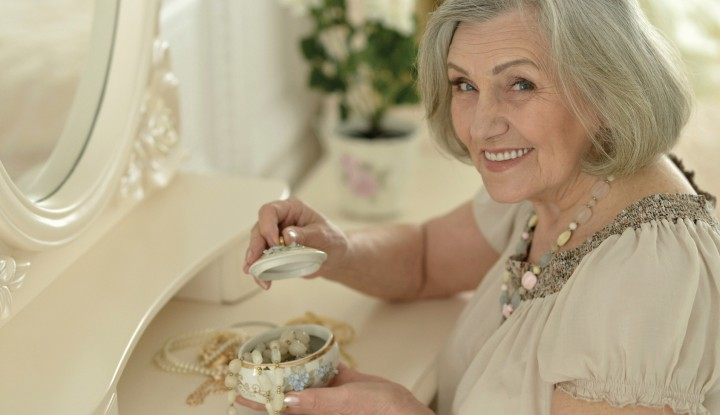 happy Senior woman portrait with jewelry box