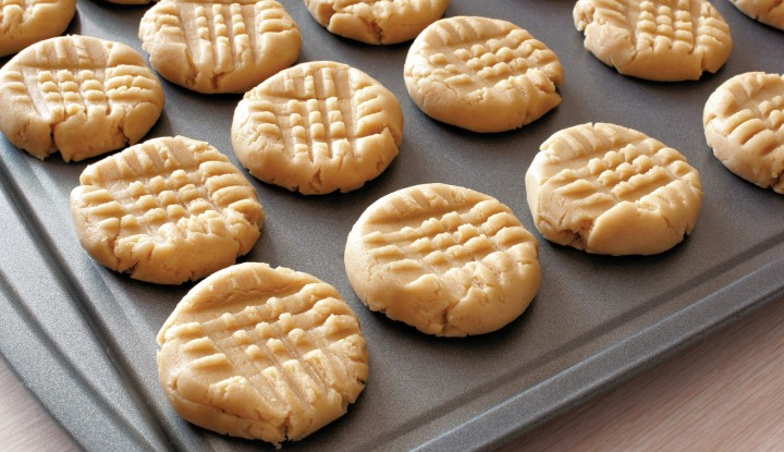3 ingredient flourless, sugar free peanut butter cookies on baking sheet