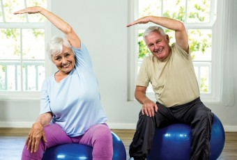 Senior Couple Stretching on Exercise Balls