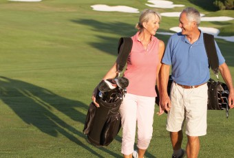 Senior Couple Walking on Golf Course