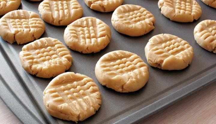 3 ingredient flourless, sugar free peanut butter cookies on baking sheet