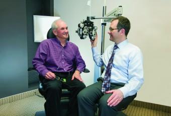 Senior man getting his eyes checked at the optometrist